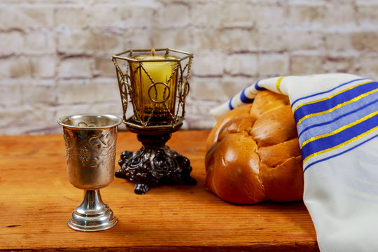Shabbat or Sabbath kiddush ceremony composition with red kosher wine