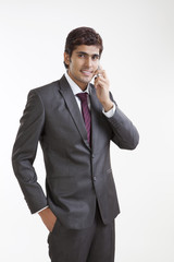 Portrait of business executive talking on a mobile phone