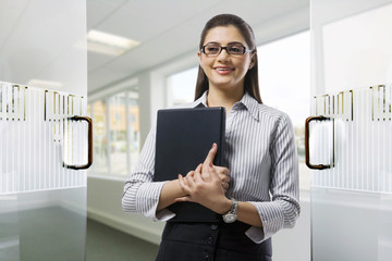 Secretary holding a laptop in the office