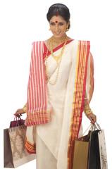Bengali woman carrying shopping bags