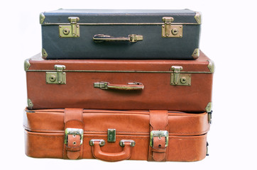 Old suitcases for travel isolated on white background