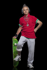 Full length portrait of senior man with skateboard