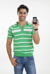 Portrait of young man with a mobile phone
