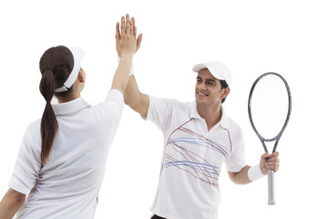 Tennis players doing high five isolated over white background