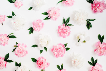 Flower pattern of pink and white peony flowers, branches, leaves and petals on white background. Flat lay, top view. Peony flower texture.
