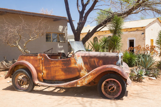Old rusty car used as decoration in Solitaire Namibia