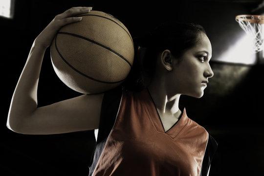 Girl posing with a basketball