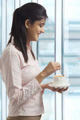Female executive having a cup of coffee