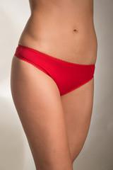 Young girl in red underwear panties