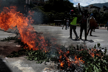 Demonstrators block a street at a rally against Venezuela's President Nicolas Maduro's government in Caracas