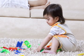 Little boy playing with toy alphabets