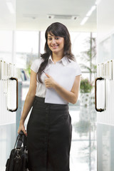Businesswoman with papers and bag