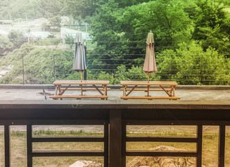 Image of wooden garden furniture, teak table, bench, chairs, parasol