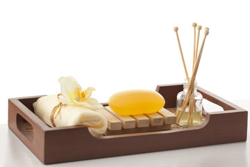 Soap , bath scrub and reed diffuser in a tray