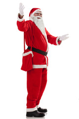 Full length of Santa Claus greeting u over white background
