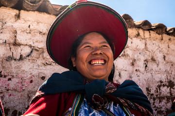 Peruvian young woman (Quechua lady) in the street of Chinchero, Peru
