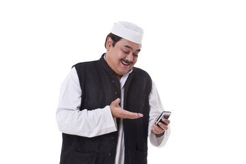 Happy politician gesturing while reading text message