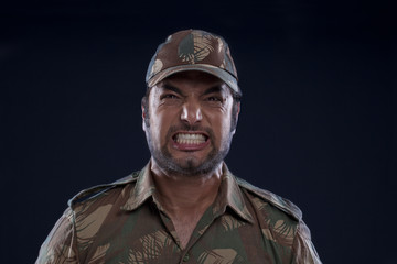 Close-up of an angry Indian soldier