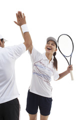 Male and female tennis players doing high five isolated over white background