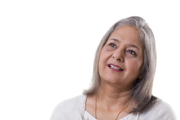 Smiling mature woman looking away over white background