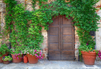 Beautiful old wooden door decorated with flowers, Italy
