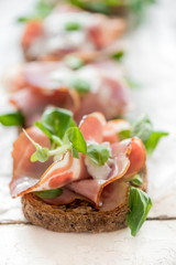 Toast sandwich with Italian prosciutto and cream cheese,selective focus
