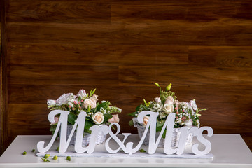 Mr and Mrs sign.on the wooden background.