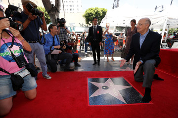 Actor Tambor poses by his star after it was unveiled on the Hollywood Walk of Fame in Los Angeles