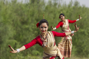 Women performing Bihu dance