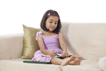Girl colouring in a book