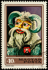 Hungarian carnival mask on postage stamp