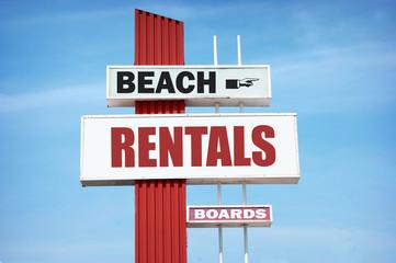 aged beach rentals sign