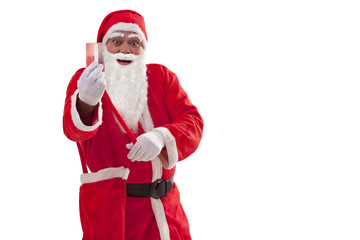Portrait of smiling Santa Claus showing credit card over white background