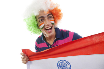 Boy cheering for the Indian team