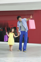 Full length of father and daughter pointing at something
