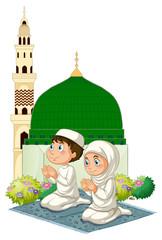 Two muslim kids praying at mosque