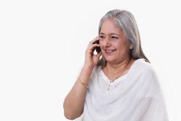 Mature woman having conversation on mobile phone