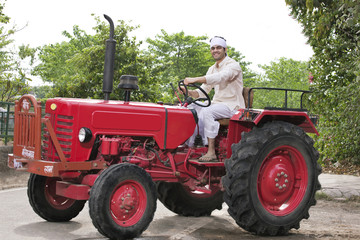 Farmer on a tractor smiling