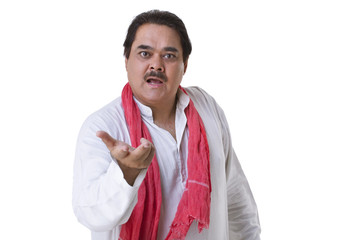Indian mature politician gesturing over white background