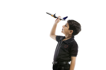 Young boy holding a model of a plane
