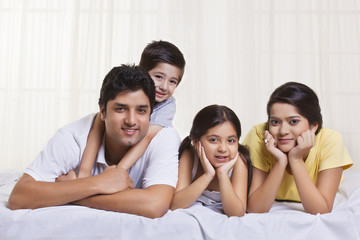 Portrait of family lying in bed