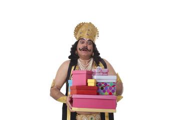 Man dressed as Raavan holding gifts and looking surprised