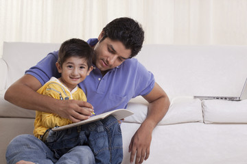 Father helping his son in drawing at home