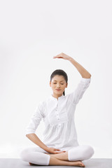 Woman with eyes closed practicing yoga