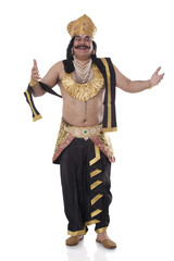 Portrait of a man dressed as Raavan gesturing
