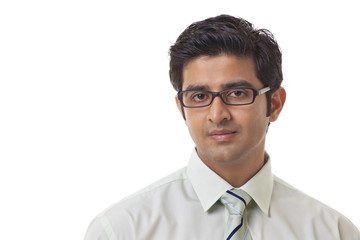 Handsome business man wearing glasses over white background