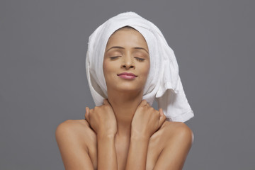 Woman smiling with a towel on head