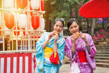 young female students wearing the kimono costume