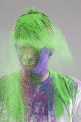 Man covered with holi colours