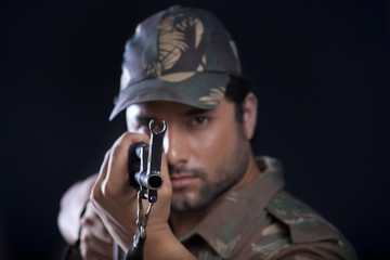 Portrait of army man aiming with a rifle